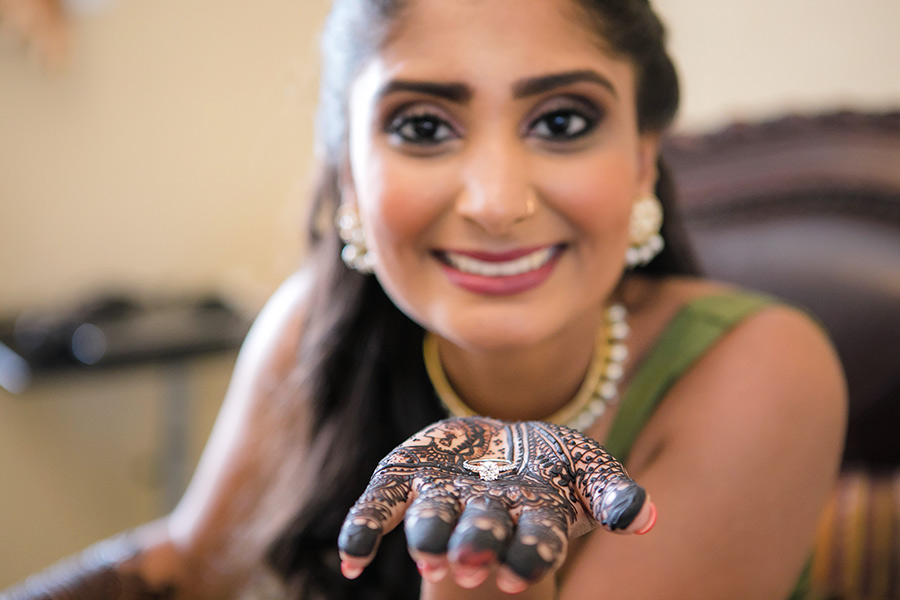 engagement ring shown on bridal henna