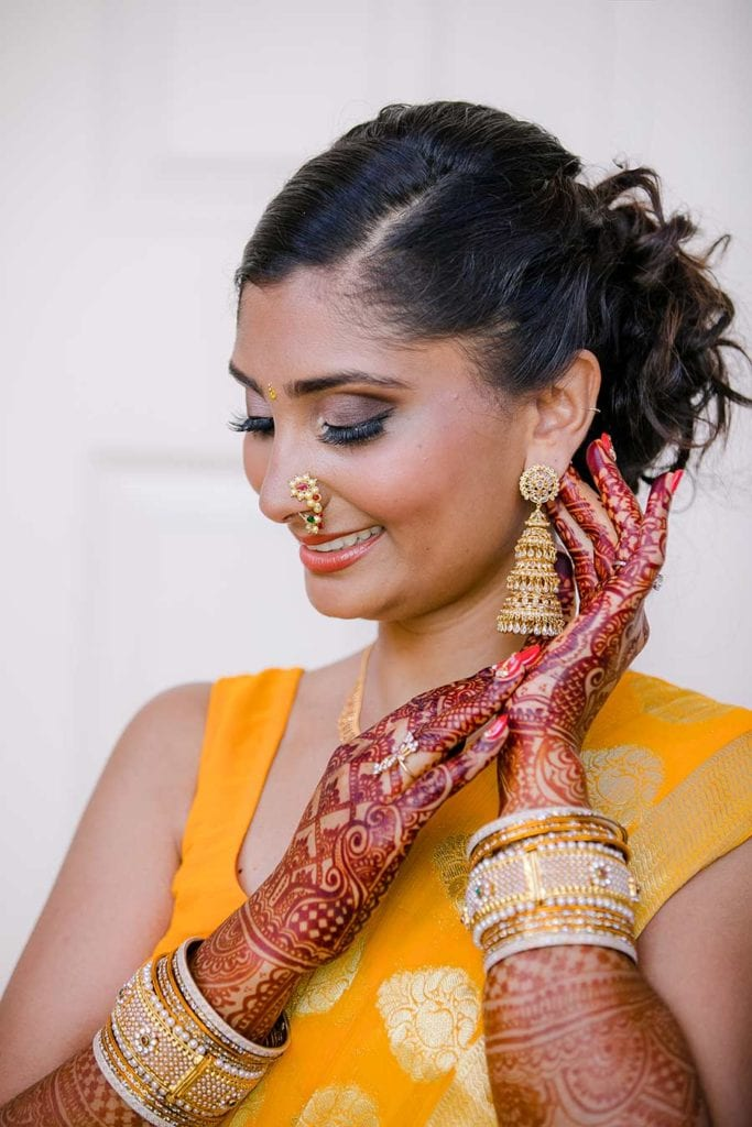 indian bridal pose wearing gold sari