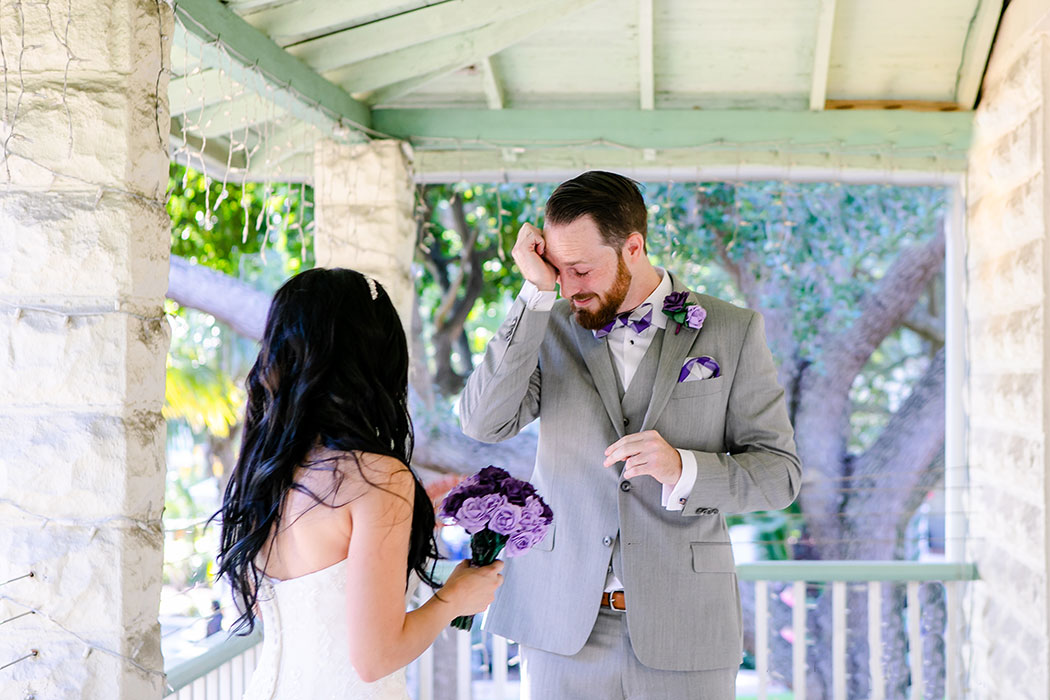 groom in grey suit and purple and white bow tie | first look wedding inspiration | groom cries at first look