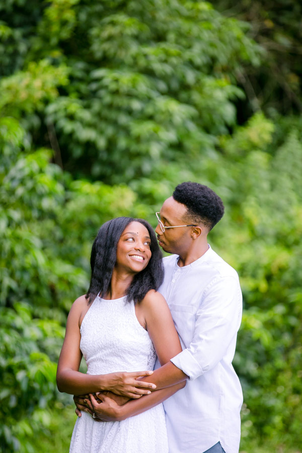 romantic engagement photography session with black couple wearing white at tree tops park, south florida
