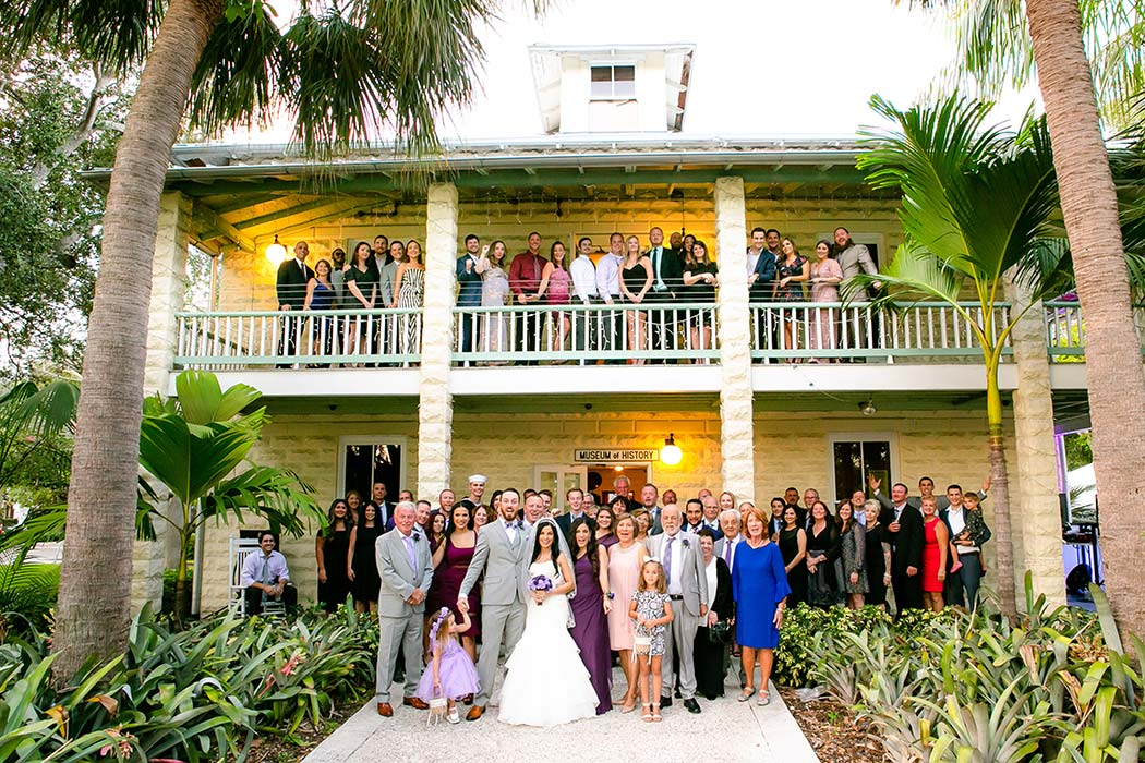 unique fun picture of whole wedding party at fort lauderdale historical society