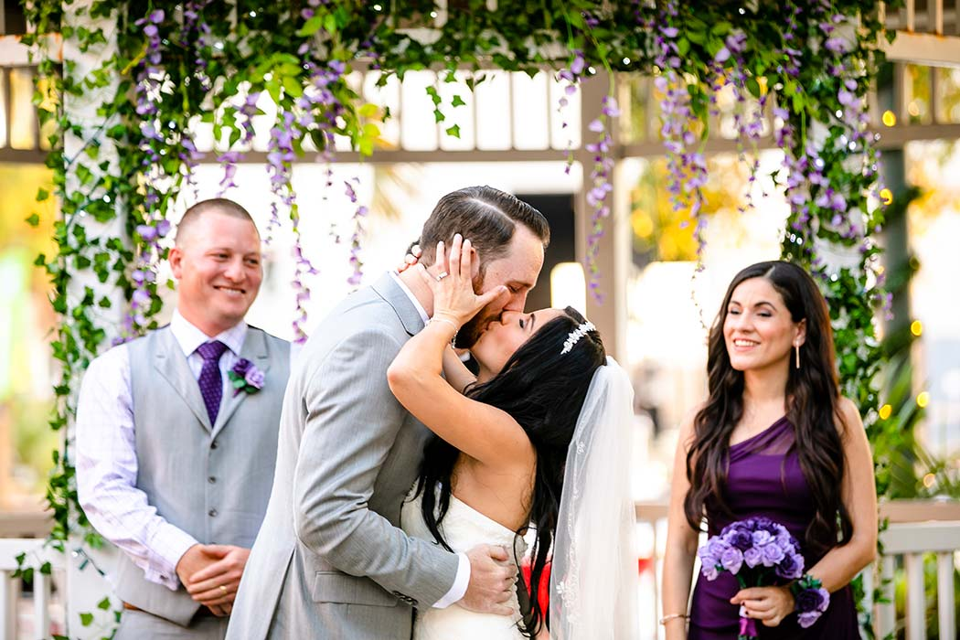 bride and groom first kiss during fort lauderdale historical society wedding