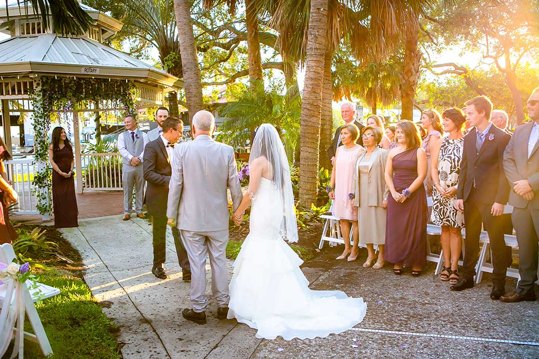 bride and her father walking down the aisle at the fort lauderdale historical society | fort lauderdale wedding photographer