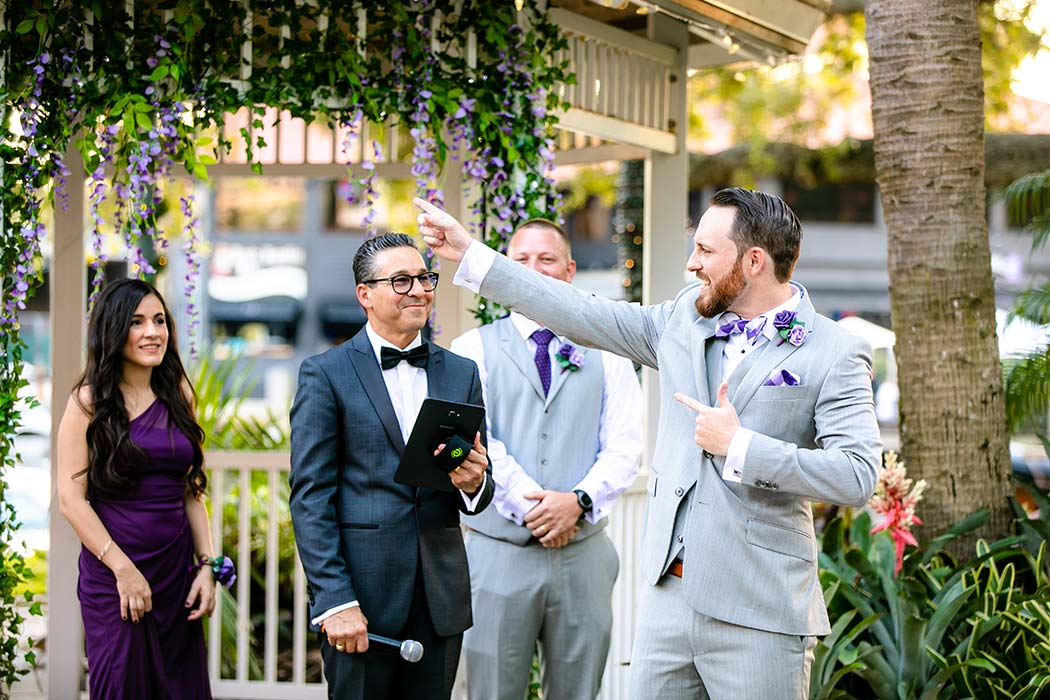 fun picture of groom waiting at the aisle