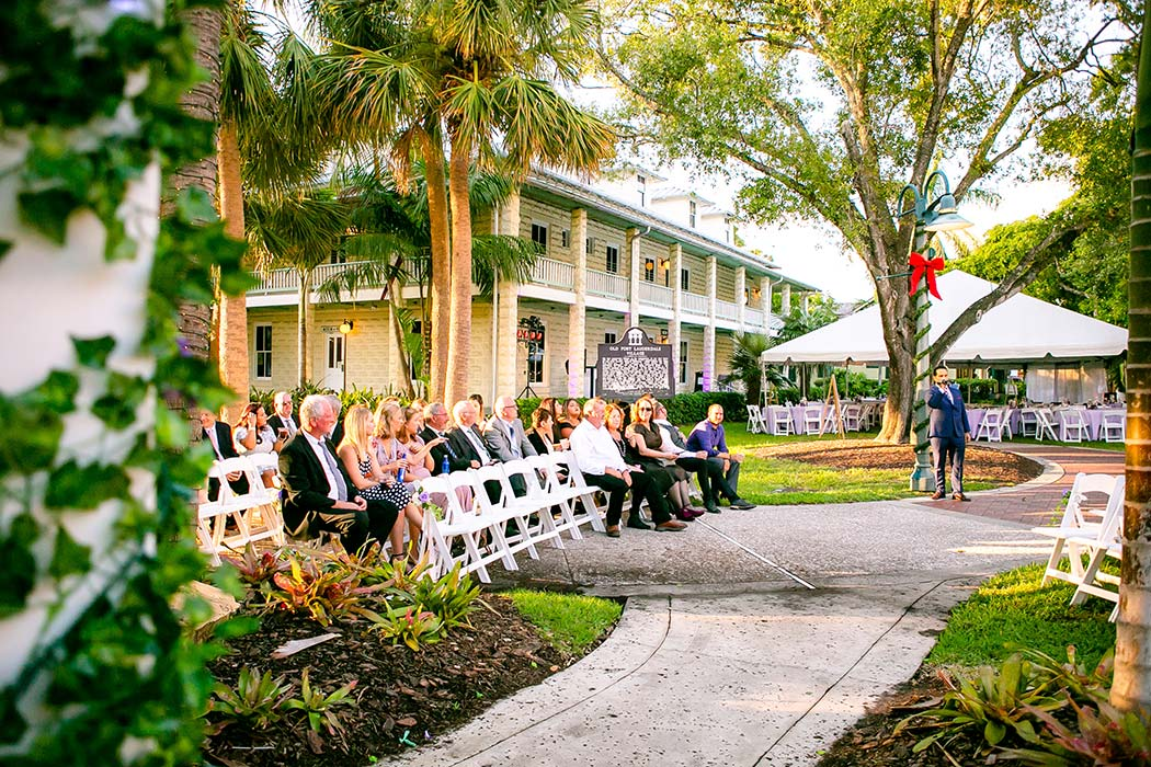 wedding guest on white chairs outside the fort lauderdale historical society