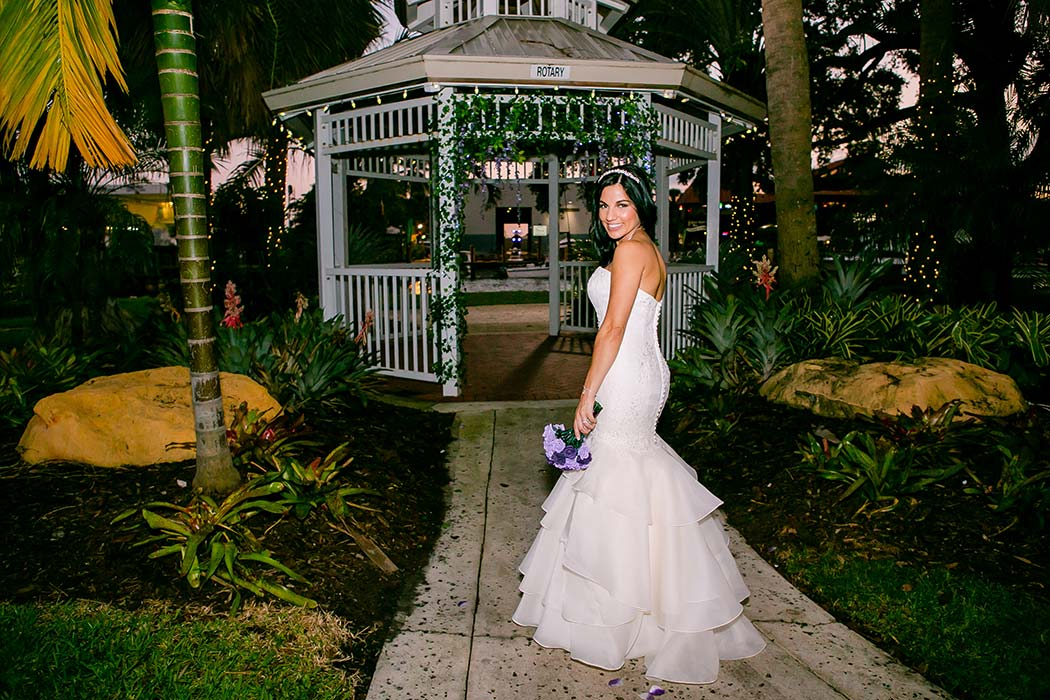 beautiful bride poses for bridal portraits in white long dress | fort lauderdale wedding