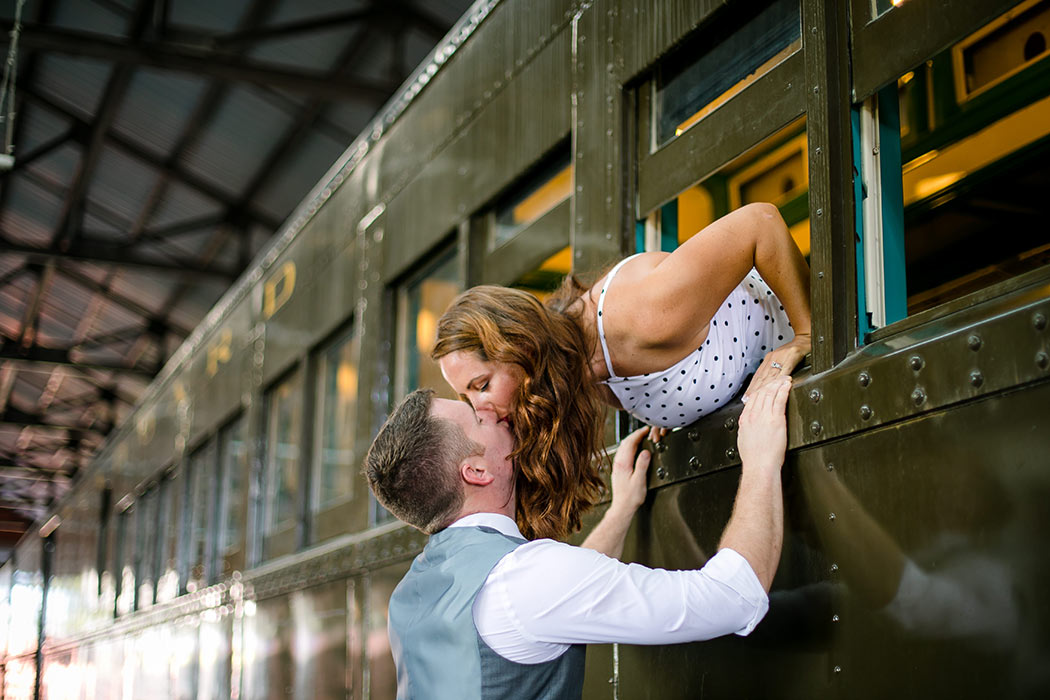 couple kissing on train carriages | vintage inspired engagement session on train | miami railroad museum engagement photoshoot