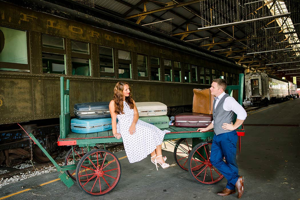 gold coast railroad museum vintage engagement photoshoot | vintage engagement photoshoot ideas | vintage luggage | fort lauderdale engagement photoagrapher