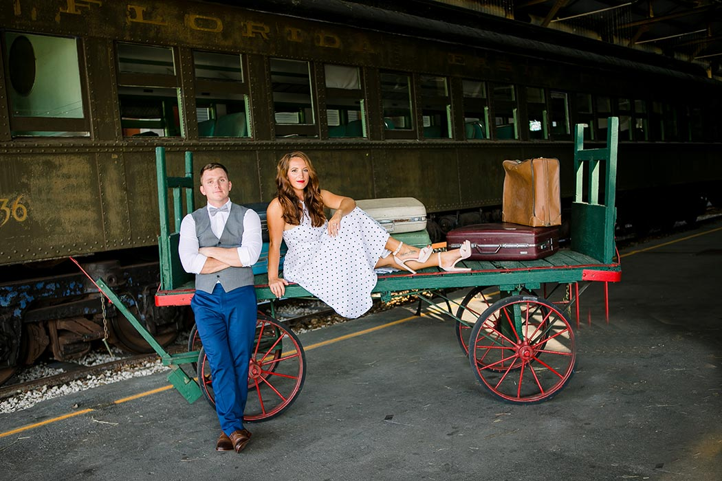 engaged couple pose for photography at miami railroad museum
