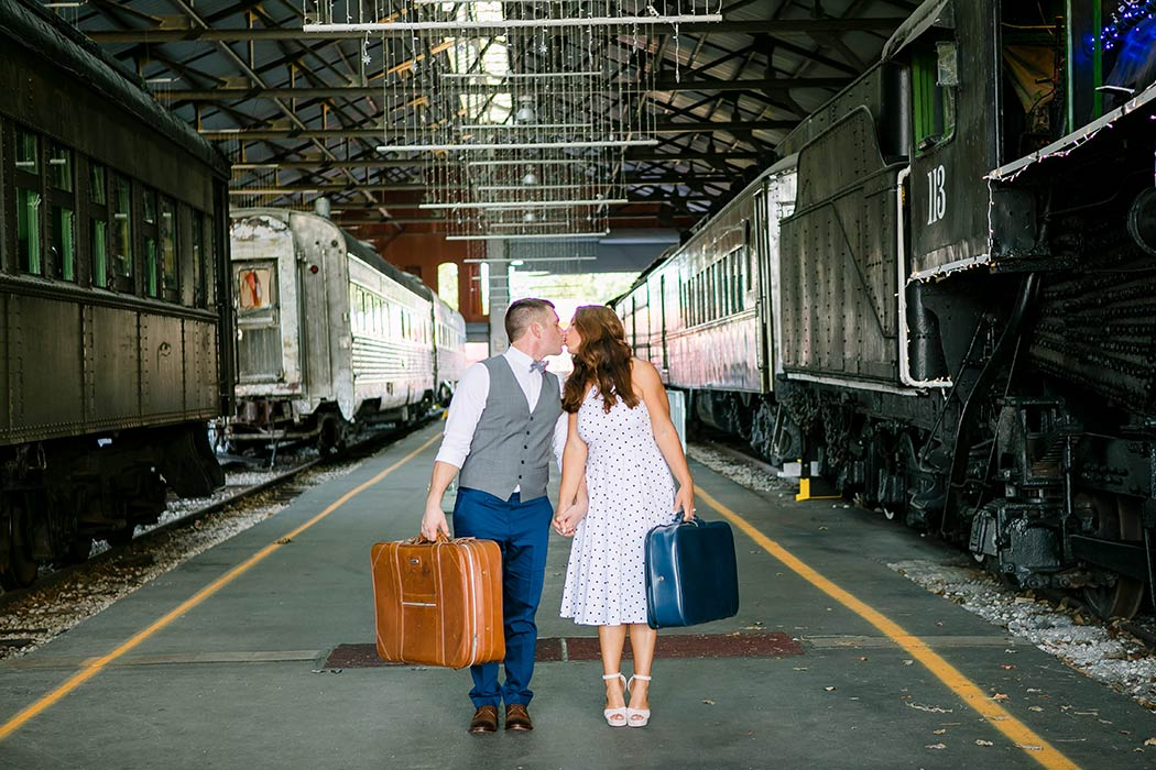 vintage inspired photoshoot with luggage in train museum | engagement photography fort lauderdale | vintage engagement session with trains