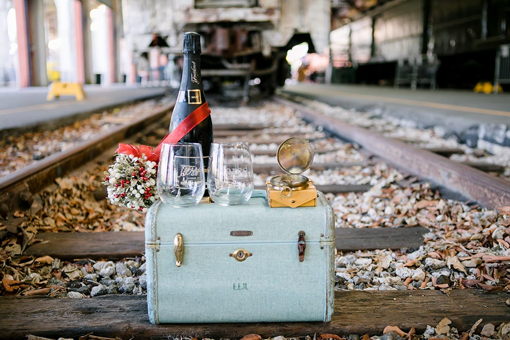 vintage luggage for photoshoot | gold coast railroad museum engagement photoshoot