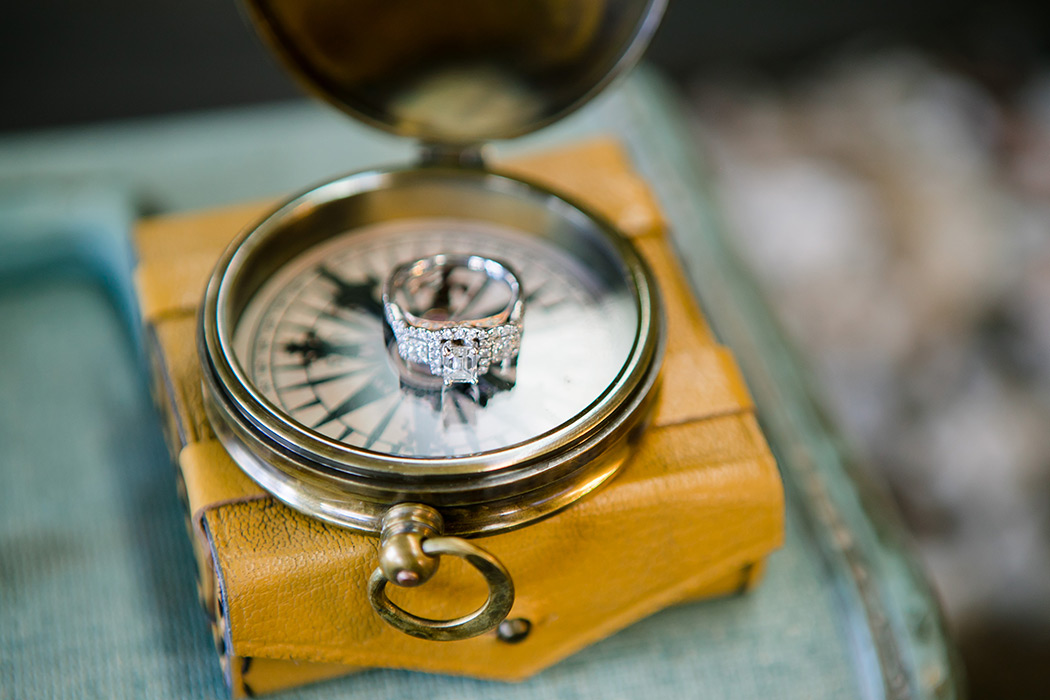 vintage compass with diamond engagement ring | vintage compass details for wedding photography