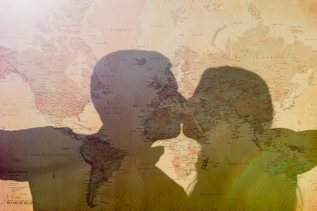 silhouette of couple through a travel map | silhouette of couple for engagement photography | map silhouette of couple