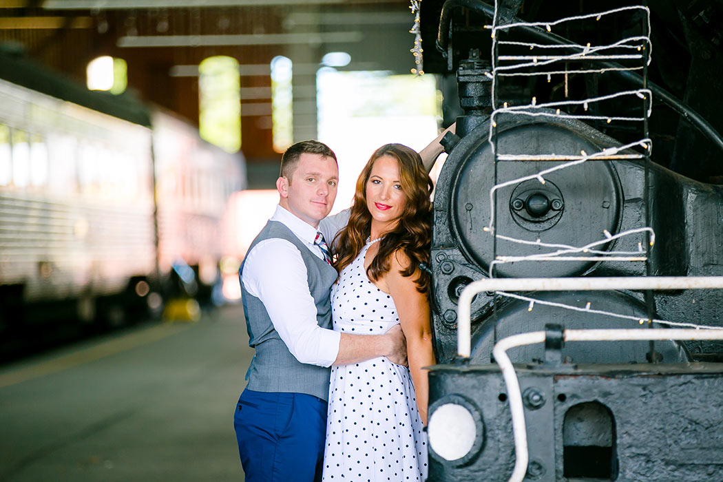 engagement photography session standing next to vintage train | vintage engagement photoshoot | railroad museum miami engagement session