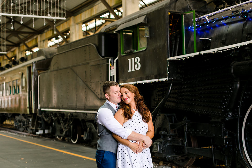 couple hugging in engagement photoshoot | vintage theme engagement | engagement in railway | engagement in railroad museum miami