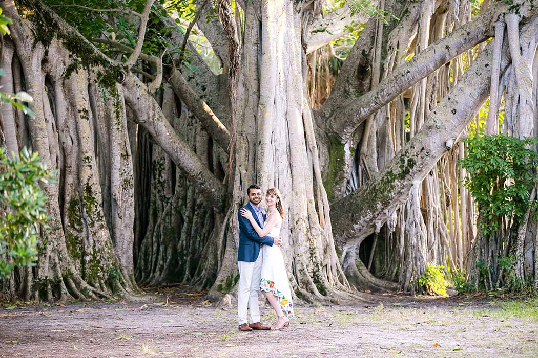 unique fun picture of engagement session in park with large tree | engagement photographer fort lauderdale