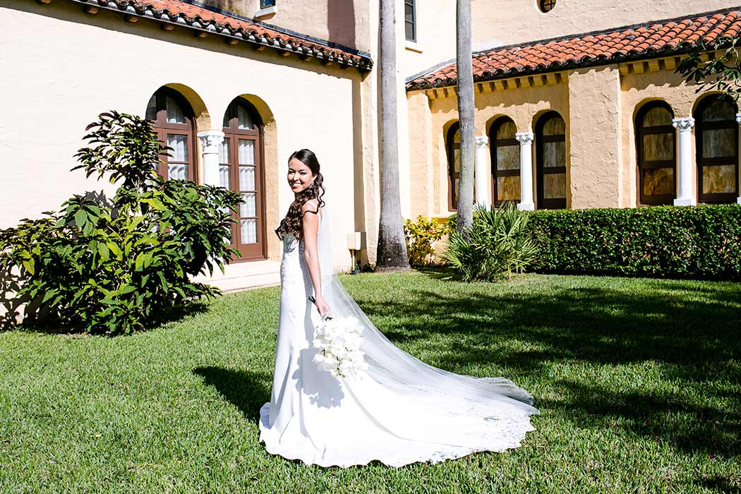 bride posing outside coral gables congregational church | fort lauderdale wedding photographer