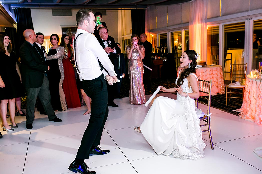 bride and groom having fun at reception | groom dances for bride | miami wedding reception