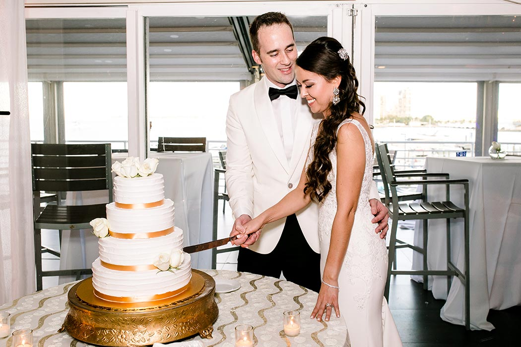 modern gold and white wedding cake | fort lauderdale bride and groom cut the cake