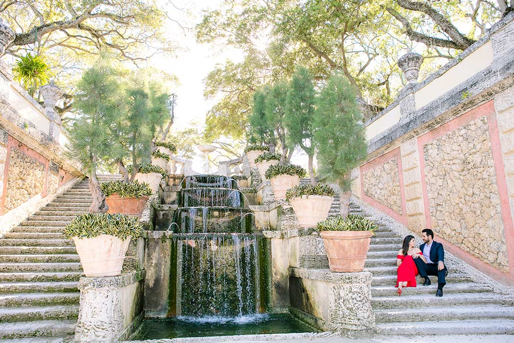 couple sitting on steps at vizcaya for engagement photos | vizcaya engagement photographer | south florida engagement photography
