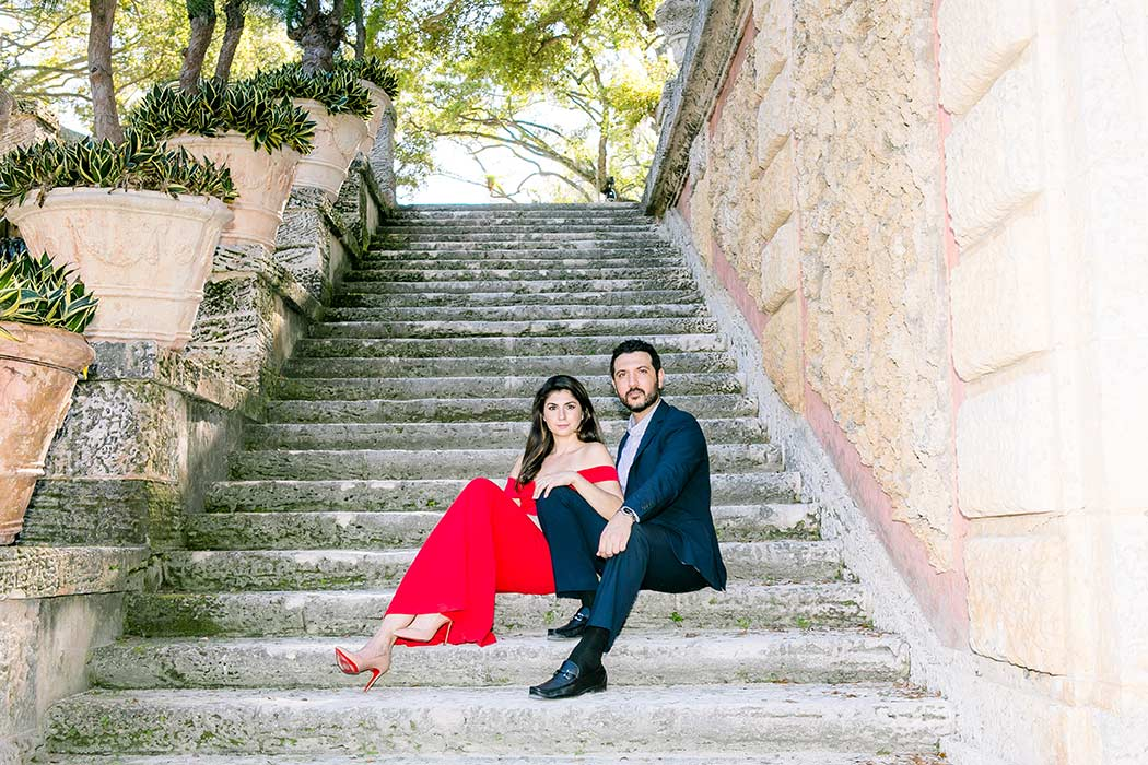 sitting pose for elegant engagement session | couple sitting on steps at vizcaya for engagement photography