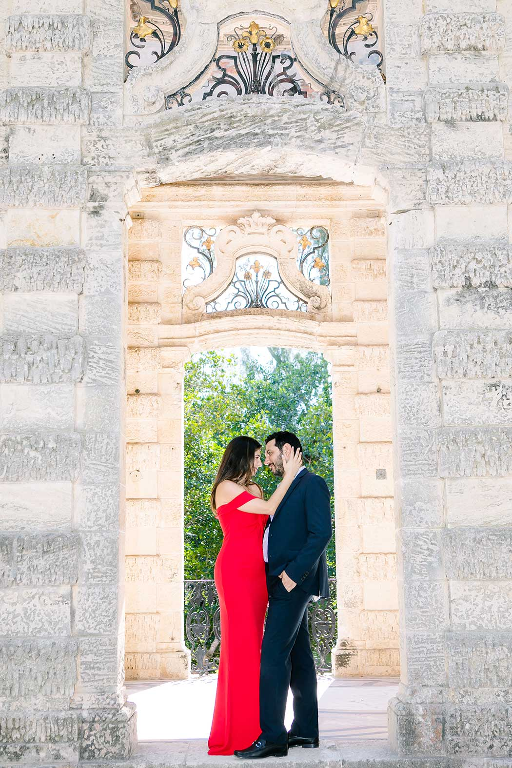 beautiful pose for engagement photoshoot at vizcaya museum miami | long red dress for engagement
