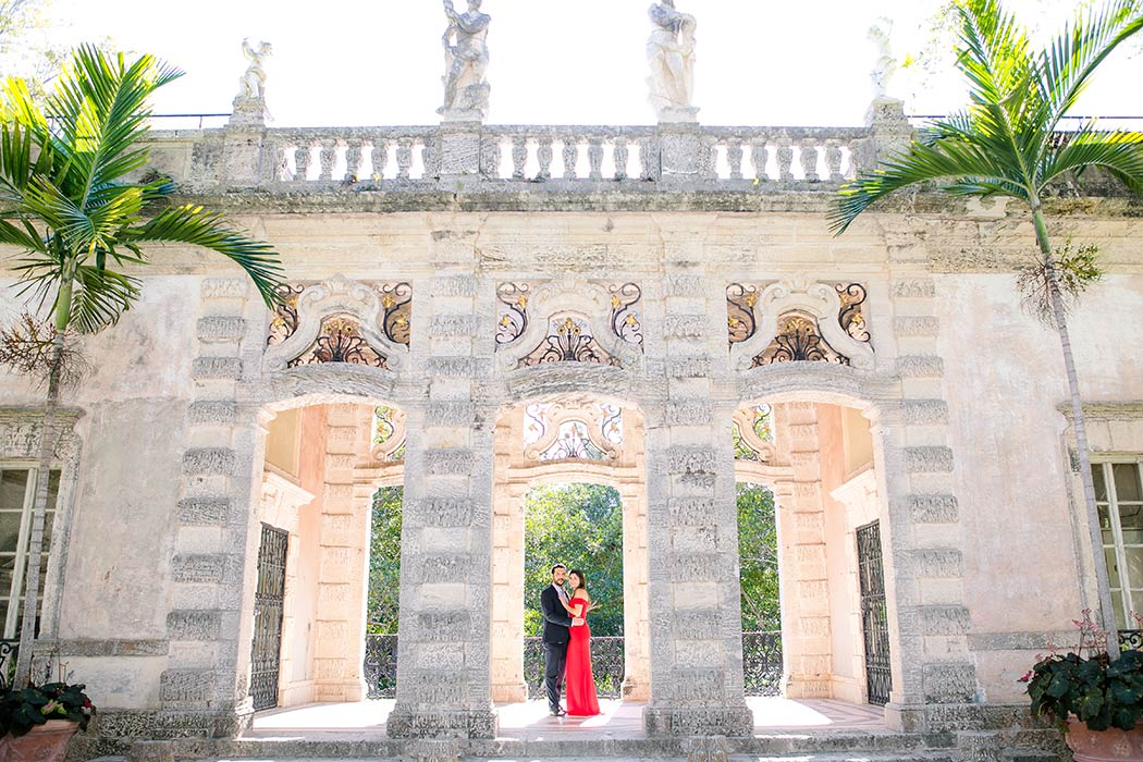 vizcaya engagement photography | long red dress for engagement session | vizcaya engagement pictures