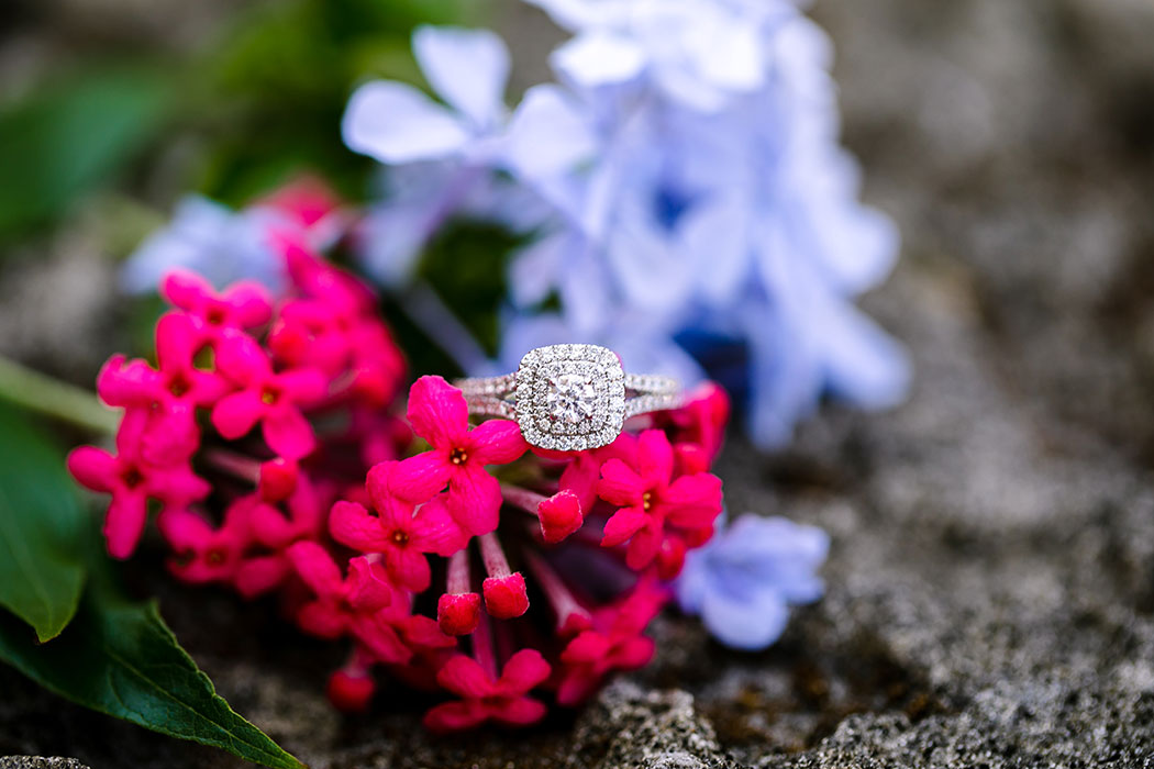 beautiful diamond square engagement ring on flowers | vizcaya photoshoot