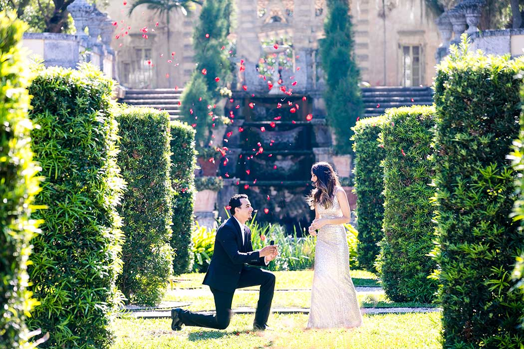 wedding proposal at vizcaya | guy on one knee proposing to girl | long sequined gold dress