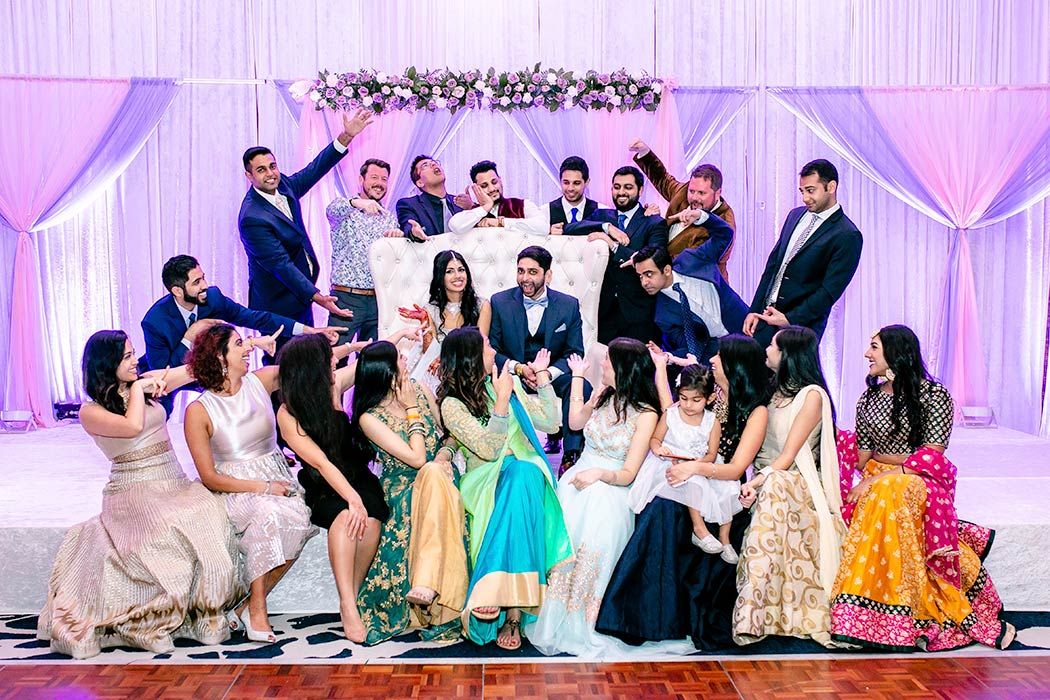 indian family group photograph on stage at wedding