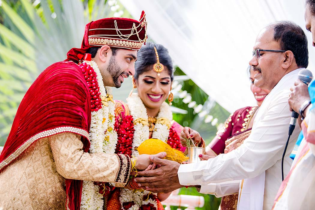 bride and groom pose for indian wedding photographs | south florida indian wedding photographer