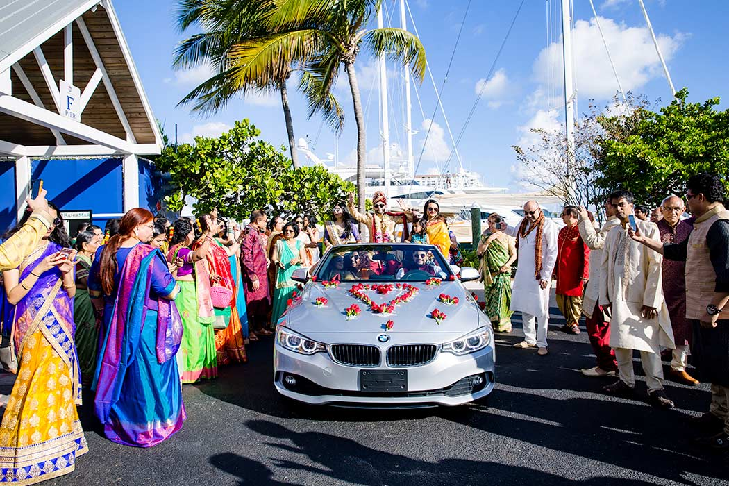 car with flowers for indian baraat | groom arrives in flowered car for wedding