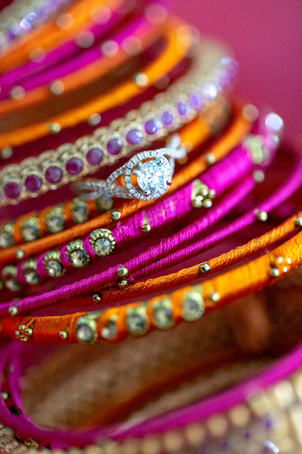 round diamond ring photographed on indian wedding bangles | wedding detail photography