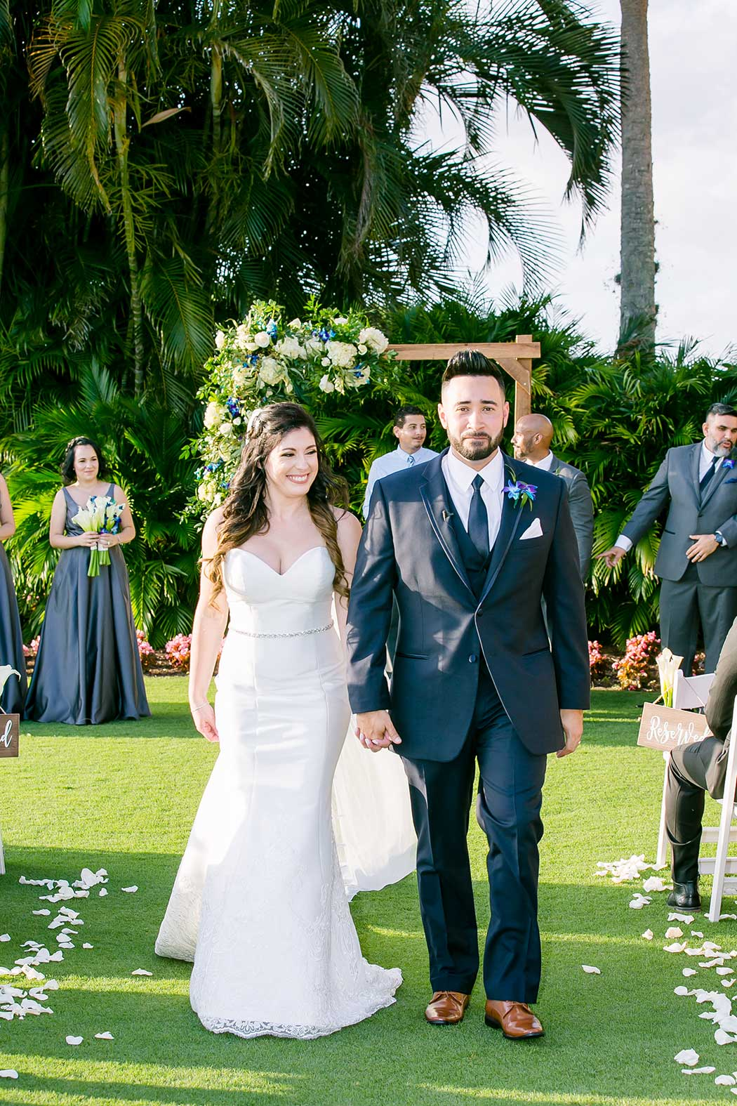modern wedding at breakers west country club palm beach | bride and groom walk down aisle