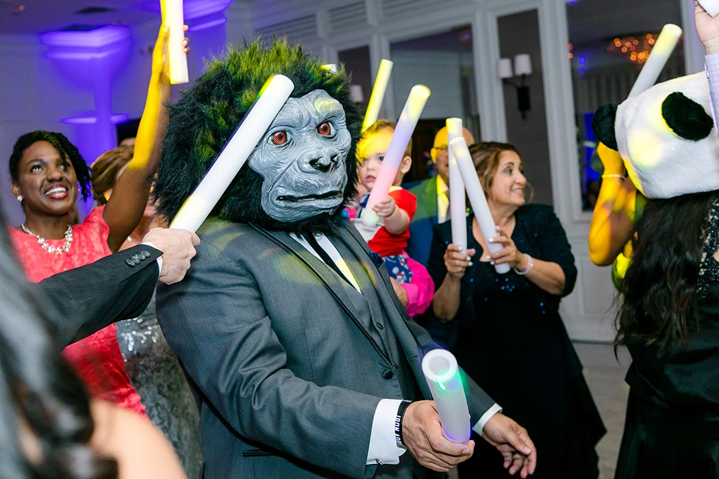 candid wedding reception photograph with gorilla holding lightsticks