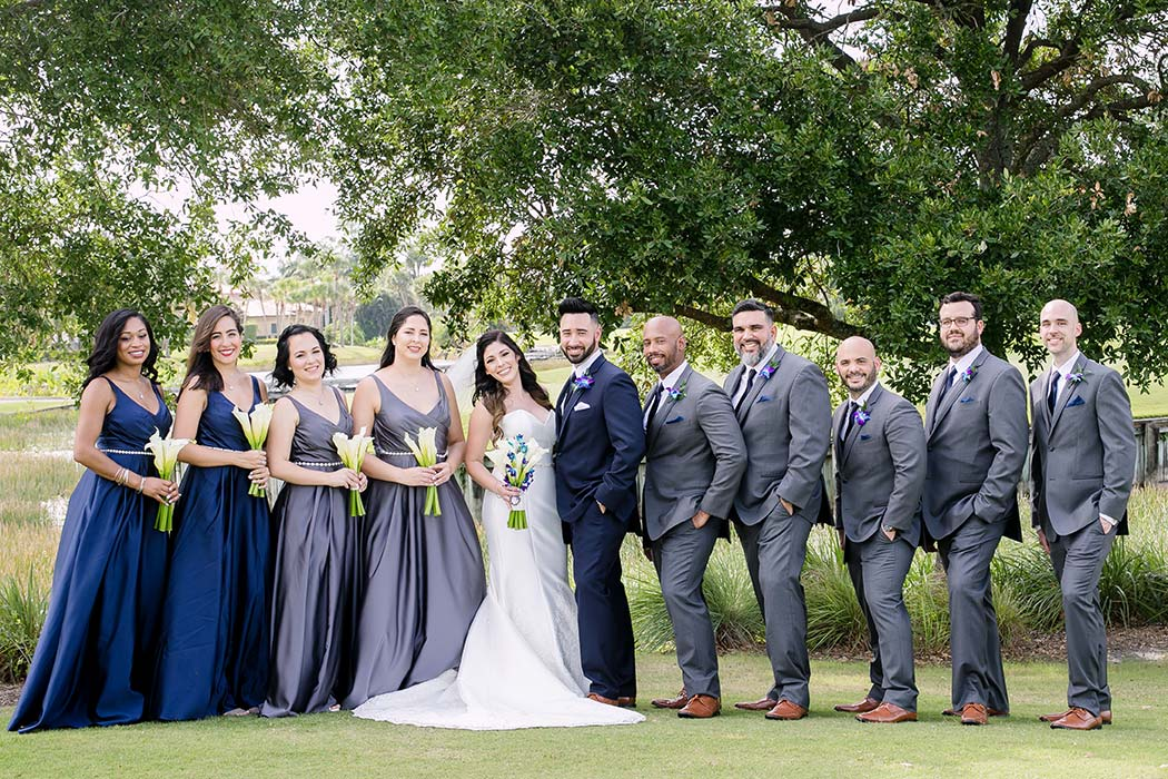 bridal party during modern wedding ceremony at breakers west country club | navy blue and grey bridemaids dresses