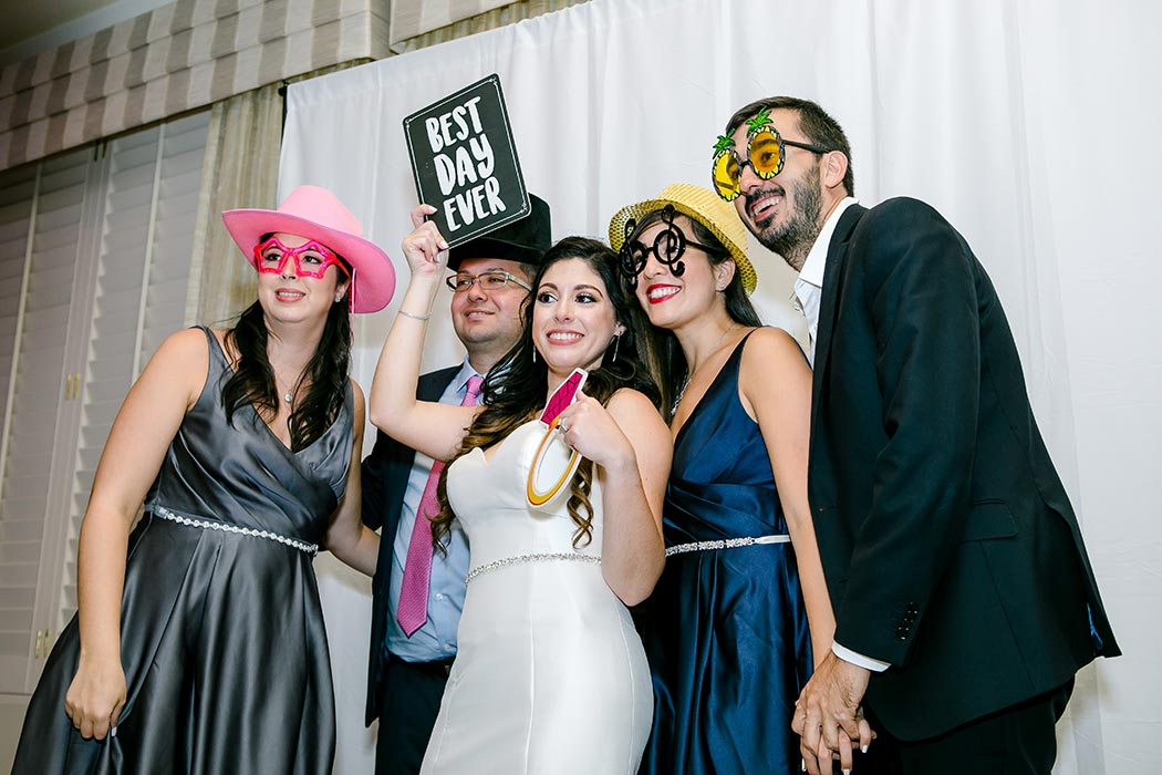 bride and guests in photobooth | modern wedding at breakers west country club | wedding photographer fort lauderdale