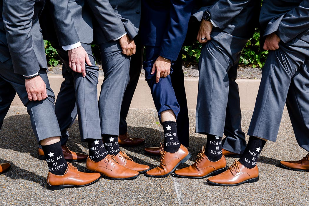 groom and groomsmen take fun photographs for wedding | unique wedding images for groomsmen | biltmore hotel miami wedding
