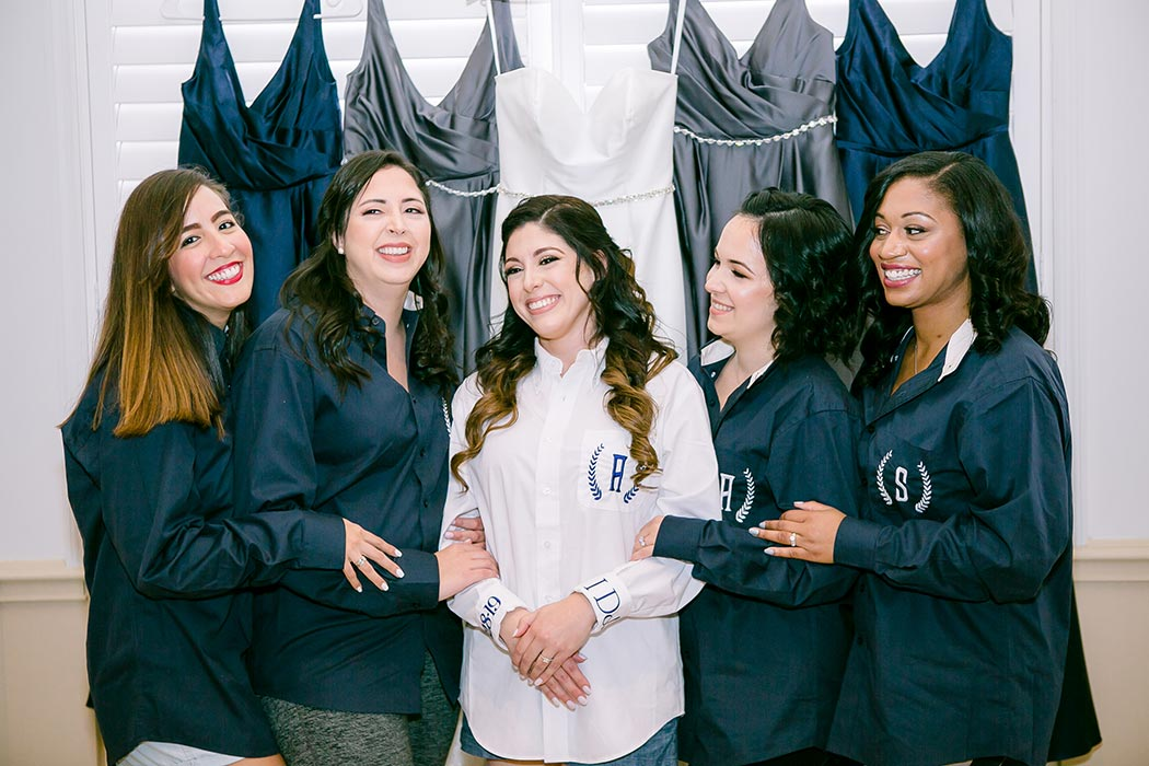 bride and bridemaids with personalized embroidered wedding shirts