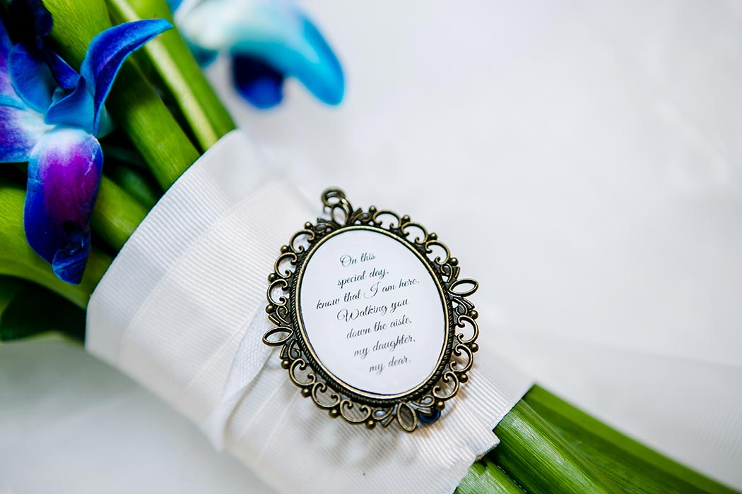 wedding detail shots on lace veil | purple orchid wedding bouquet | personalized wedding bouquet locket