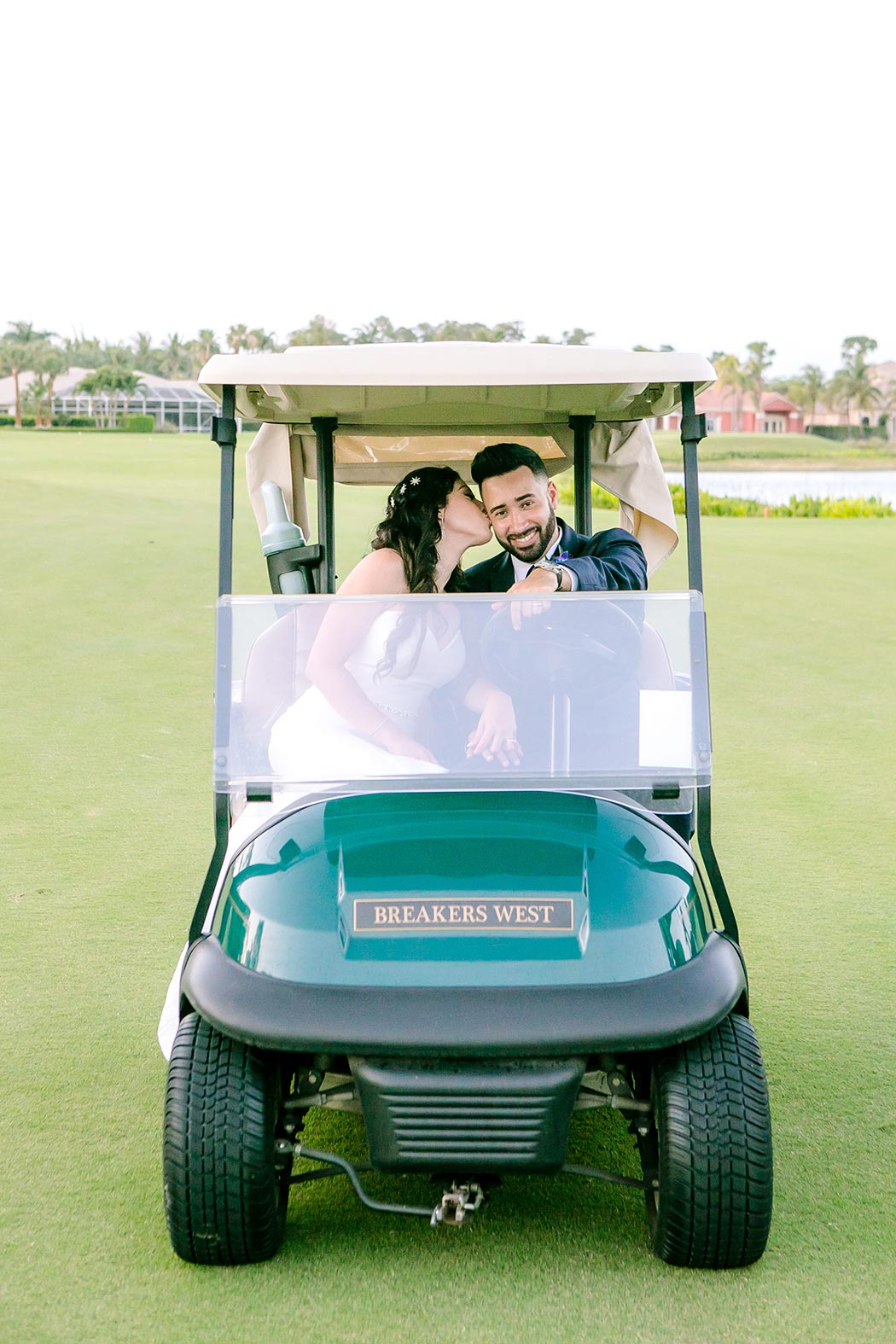 bride and groom fun picture in golf cart