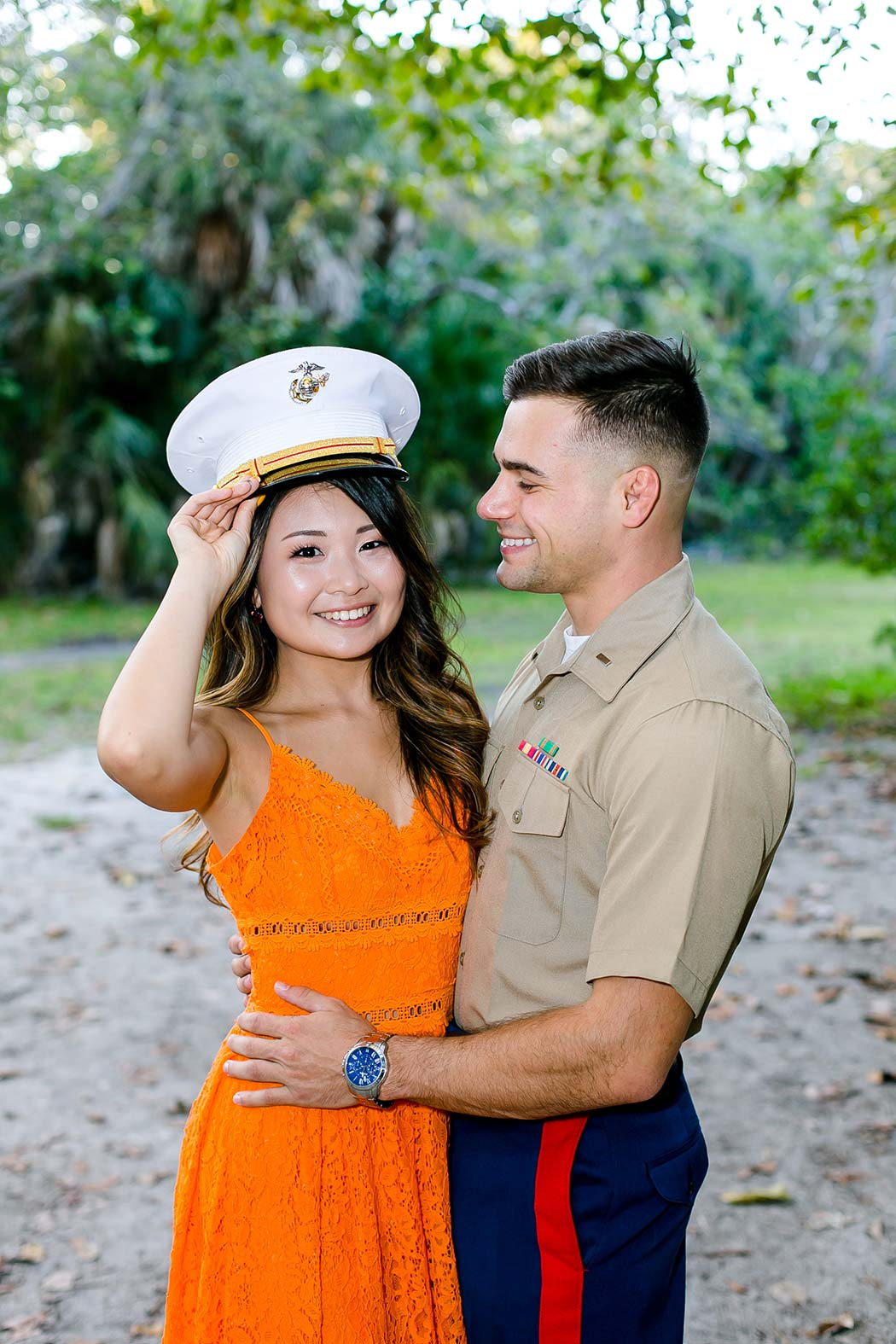 engagement photoshoot with orange dress | military engagement photoshoot | girl wears military cap during engagement session