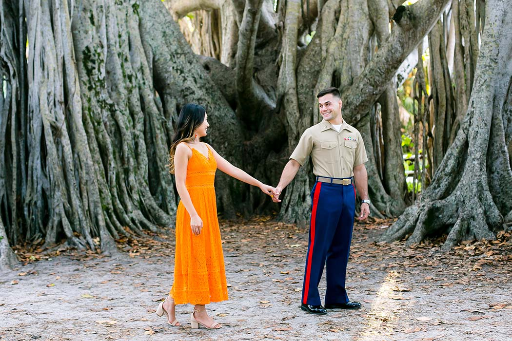 couple pose for engagement photoshoot in hugh taylor birch park fort lauderdale | park engagement session fort lauderdale