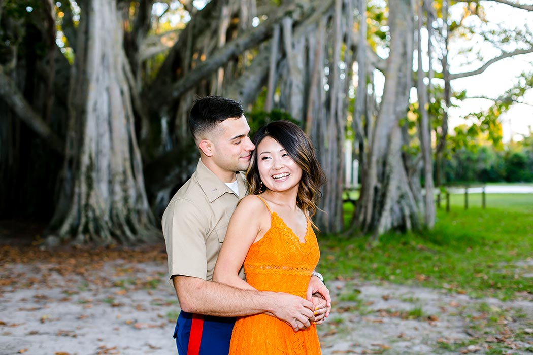 engagement photoshoot with man in military uniform | couples pose for engagement in park