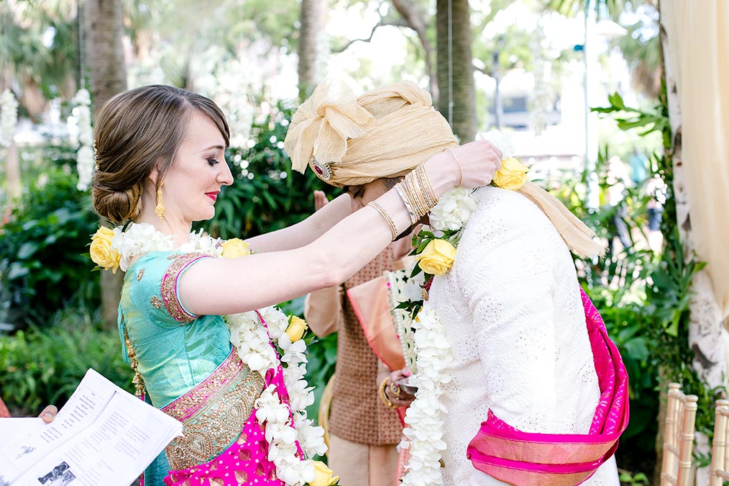 indian bride and groom exchanging flower garlands | modern indian fusion wedding ceremony in south florida
