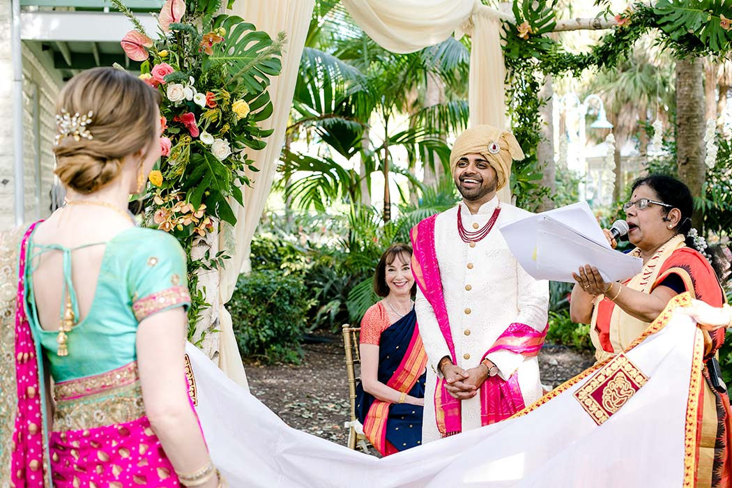 modern indian catholic wedding | fort lauderdale indian wedding | bride revealed to indian groom on mandap