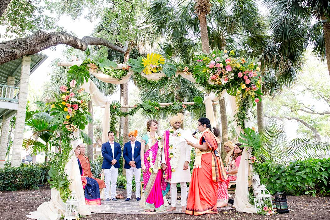 beautiful modern colorful indian mandap | colorful indian wedding mandap | indian wedding mandap outside | tropical flowers on indian mandap