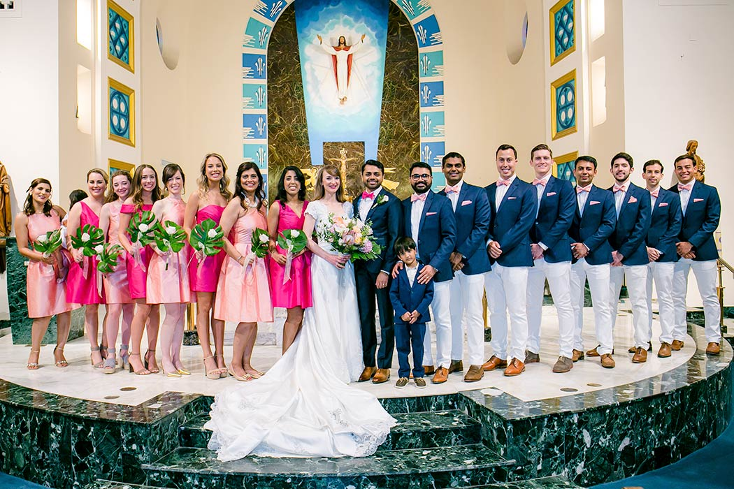 unique wedding party photography | pink bridesmaids dresses | church wedding bridal picture