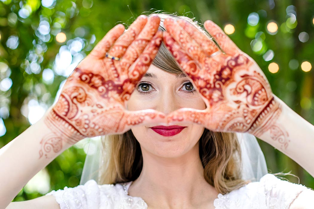 unique henna art photography | bride showing henna on hand | bridal henna photography | fort lauderdale bride shows henna on hand