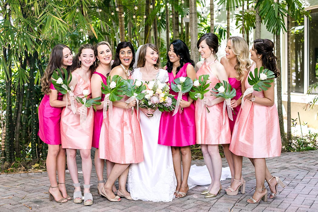hot pink short bridesmaids dresses | pink bridesmaid dresses | tropical indian wedding in fort lauderdale | bride and bridesmaids in pink | unique bridesmaids dresses